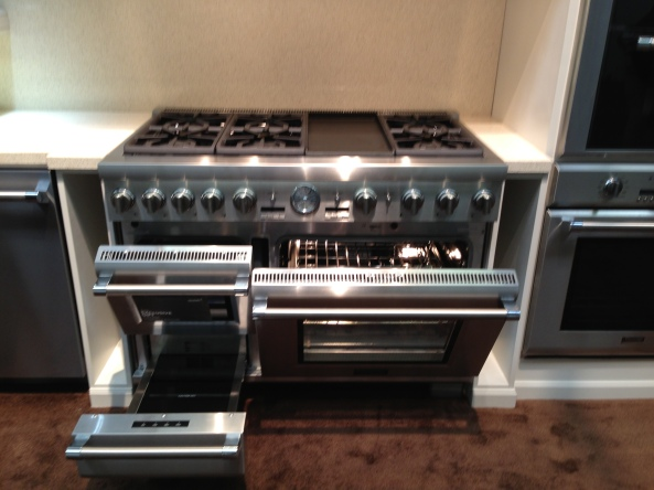 Steam oven, warming drawer, convection oven, griddle, and six burners.  The only thing it doesn't do is your taxes...