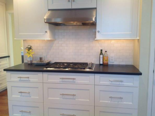 Image of Wolf's 30 inch cooktop model CT30GS and a Ventahood, model SLH9130SS
